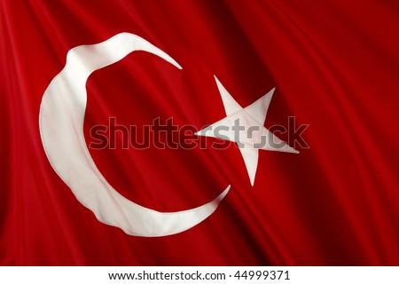 Close up shot of wavy, shiny Turkish flag - stock photo