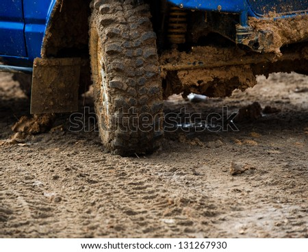 close-up shot of wheel in dirt. - stock photo