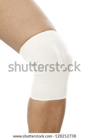 Close-up shot of white bandaged on the knee - stock photo