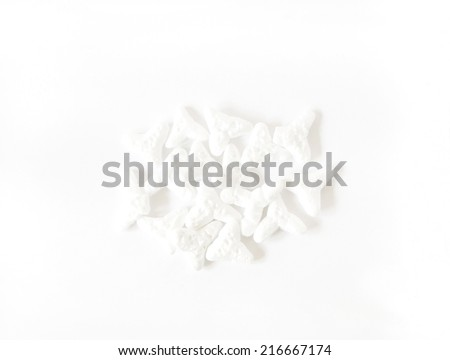 close-up shot of white foam packing material used for shipping isolated on white background with shadow - stock photo