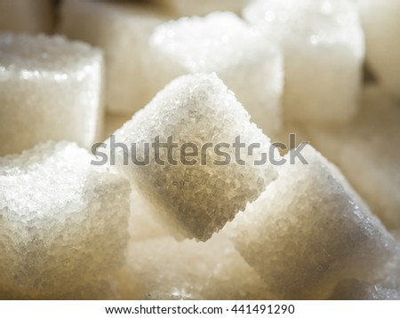Close up shot of white refinery sugar. - stock photo