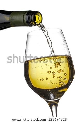 Close-up shot of wine bottle pouring wine in wine glass against white background. - stock photo