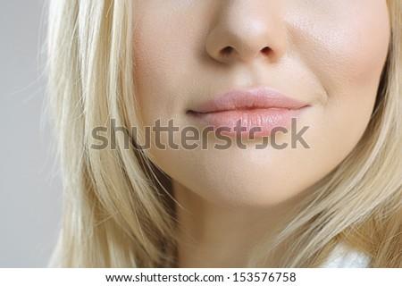 Close-up shot of woman lips - stock photo