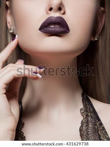 Close-up shot of woman lips with colorful lipstick