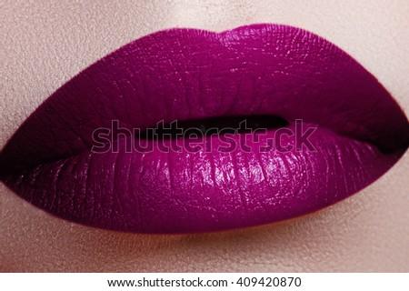Close-up shot of woman lips with glossy fuchsia lipstick. Perfect fuchsia lips. Sexy girl mouth close up. Beauty young woman smile. Fuchsia plump full Lips. Lips augmentation.  Bright full lips - stock photo