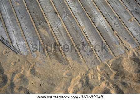 Close-up shot of wooden path on the beach - stock photo