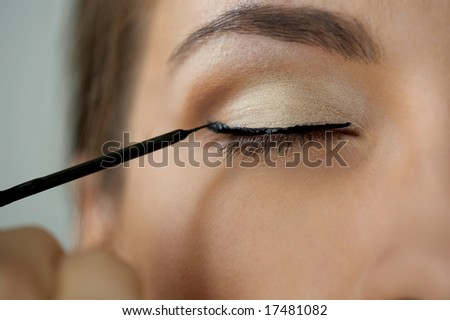 Close-up shot of work of make-up specialist. Low-focus image.