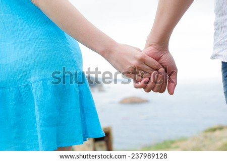 close up shot of young caucasian couple hands - stock photo