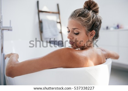 Close up shot of young woman in bathtub  Female taking bath in bathroom. Woman In Bathtub Stock Images  Royalty Free Images   Vectors