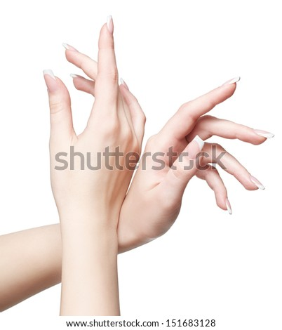 close-up shot of young woman's hands with french manicure on white - stock photo