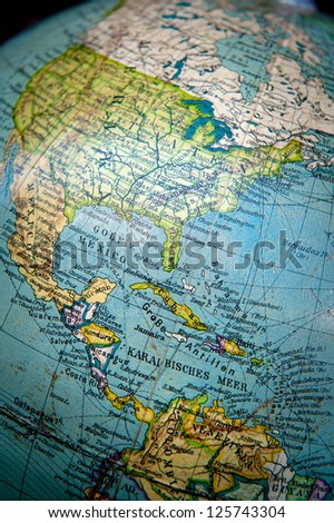Close up shot on a vintage world globe focused on Central and North America - stock photo