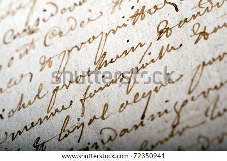 Close-up shot on an old manuscript written in French - stock photo