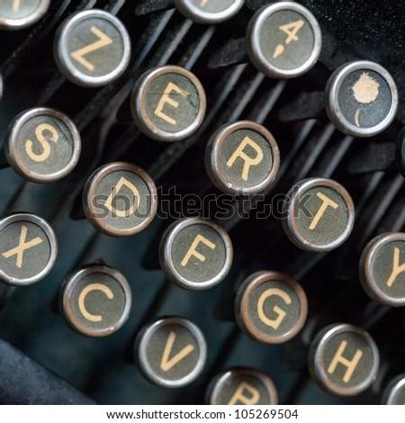 Close up shot on vintage typewriting machine keys - stock photo