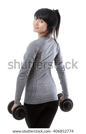 Close up shot, taken from behind, of a pretty young fitness model holding weights. isolated on white.