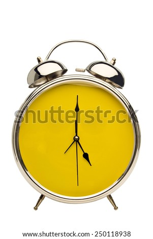 Close Up Shot Vintage Alarm Clock With Yellow Face - stock photo