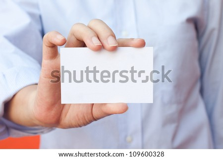 Close up shot young business woman holding empty business card
