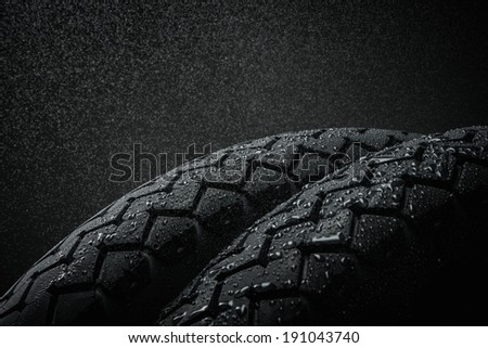 Close-up shots of classical motorcycle tires tread in wet weather condition  - stock photo
