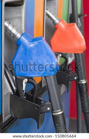 close up side view fuel nozzle fuel oil gasoline at petrol filling station