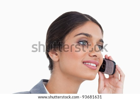 Close up side view of female entrepreneur on her cellphone against a white background