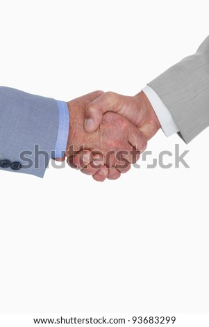Close up side view of shaking hands against a white background