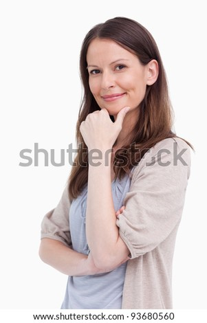 Close up side view of thoughtful smiling woman against a white background