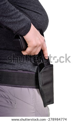 Close up side view of womans hand puts the gun in the holster on a white background - stock photo