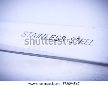 Close up sign on tweezers. Vignette. Very small depth of sharpness.