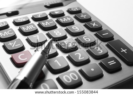 close up silver calculator with pen on white paper - stock photo