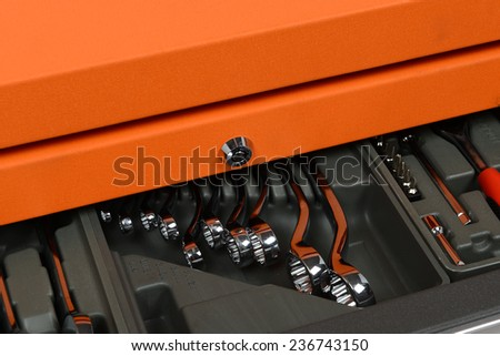 Close up, silver chrome-plated wrench spanner in Tool Cabinets - stock photo