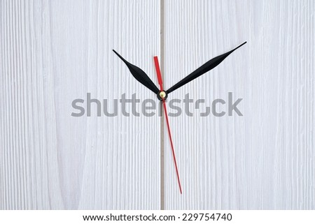 Close up simple clock or watch hands on white concrete wall displaying time o'clock - stock photo