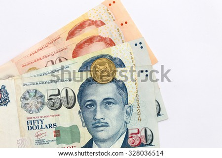 close up  singapore money with coins on white background - stock photo
