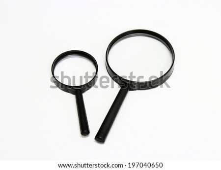 Close up Single Magnifying Glass - stock photo