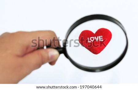 Close up Single Magnifying Glass with love - stock photo