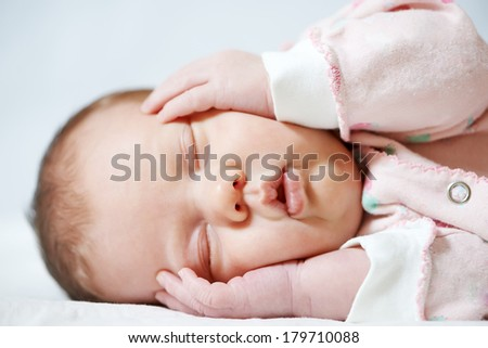 Close-up sleeping newborn baby - stock photo