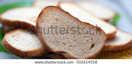 Close up slices of toasted white bread