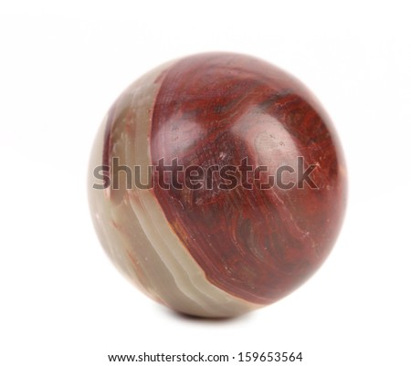 Close up small ball of jasper. Isolated on a white background. - stock photo