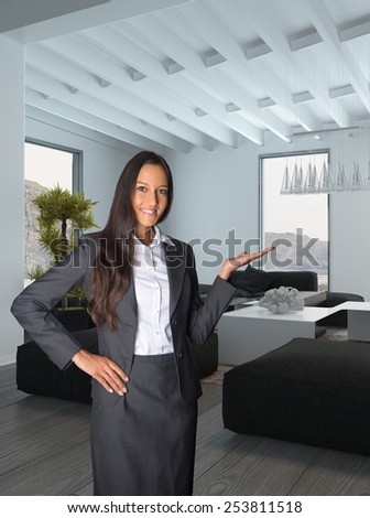 Close up Smiling Female Agent Showing the Architectural House Living Room. Background image is a 3d Rendering - stock photo