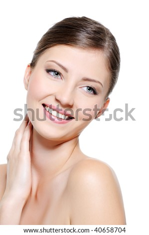 Close-up smiling  female face with a pure skin over white background - stock photo