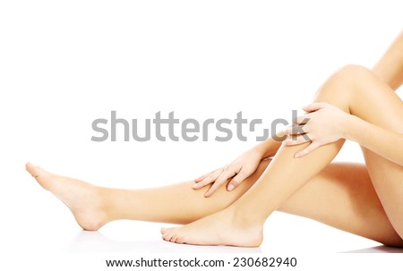 Close up smooth female legs. - stock photo