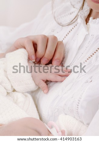 close up soft image of little baby fingers, maternity concept