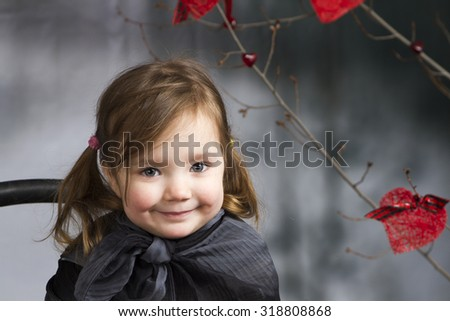 Close up soft portrait of little girl in the studio interior - stock photo