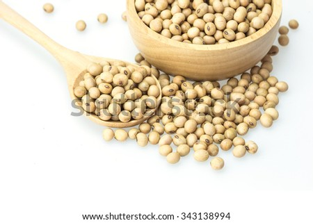 Close up soy beans in spoon isolated on white background - stock photo