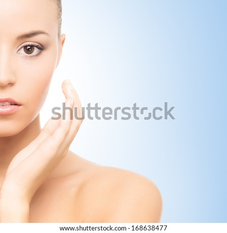 Close-up spa portrait of young, beautiful and healthy girl over blue background