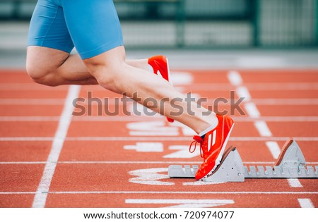 Close up Sprinter Athlete leaving starting blocks on the running track