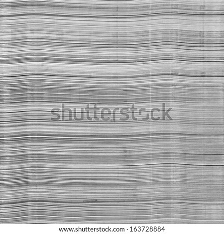 Close up stack of dirty paper in printing house - stock photo
