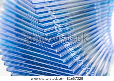 Close up stack of DVD and CD cases - stock photo