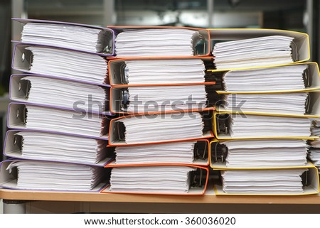 Close up stack of paper on the office desk - stock photo