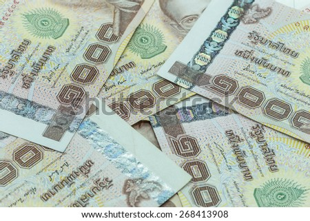 Close up stack of Thai money in one thousand type banknotes - stock photo
