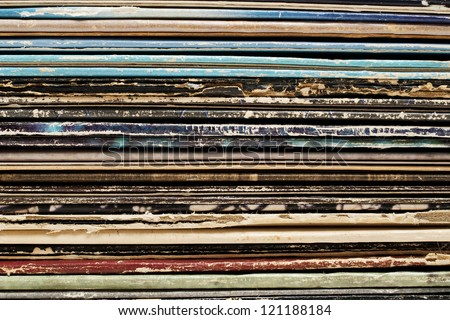 Close up stack of vintage vinyl records in sleeves - stock photo