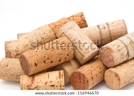 Close up stack of wine corks on white background - stock photo